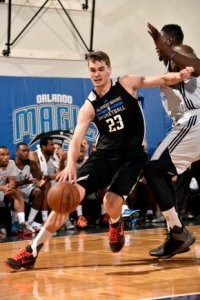 ORLANDO, FL - JULY 6: Mario Hezonja #23 of the Orlando Magic Blue drives against the Oklahoma City Thunder on July 6, 2015 at Amway Center in Orlando, Florida. NOTE TO USER: User expressly acknowledges and agrees that, by downloading and or using this photograph, User is consenting to the terms and conditions of the Getty Images License Agreement. Mandatory Copyright Notice: Copyright 2015 NBAE  (Photo by Fernando Medina/NBAE via Getty Images)