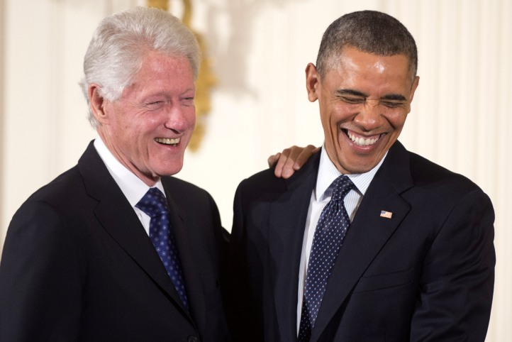 President Barack Obama and former President Bill Clinton laugh before Obama awarded him with a Presidential Medal of Freedom, during an event in the East Room at the White House in Washington, D.C., November 20, 2013.  UPI/Kevin Dietsch